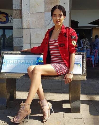 Actress and Voiceover Artist Seneo Mabengano sitting on a bench