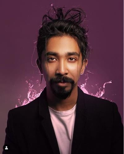 Portrait of Bahraini influencer Salah Abdulmajid against a purple background