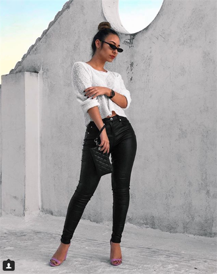 Digital Influencer Rania Karpodini wearing white shirt and black metallic jeans