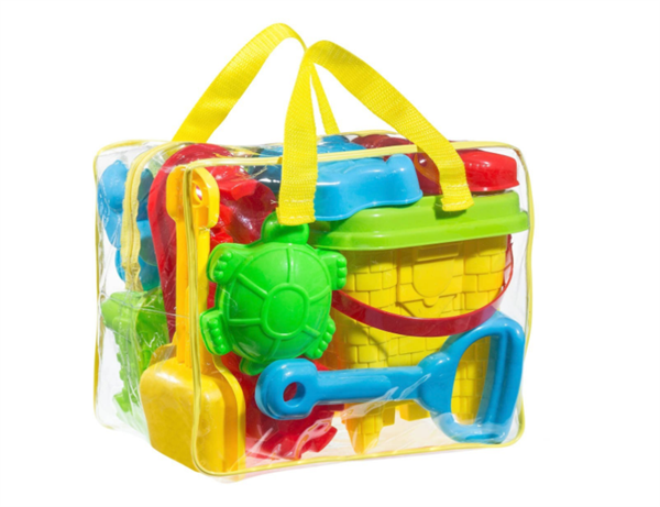 Clear bag filled with sand toys like shovel and pale