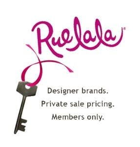 Rue La La logo with a silver key