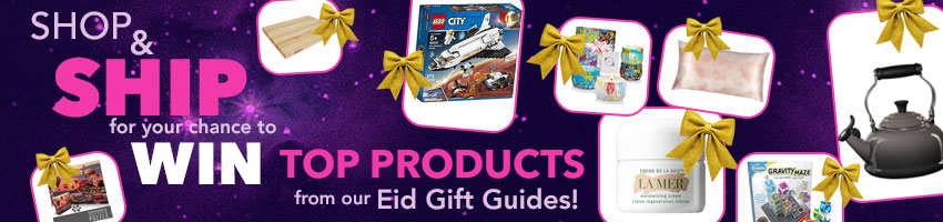 White squares highlighting prizes: John Boos cutting board, 1000 piece puzzle, LEGO Mars shuttle set, candles , La Mer moisturizer, Gravity Maze game, Slip silk pillowcase, and Le Creuset kettle; with gold ribbon bows against a dark purple background