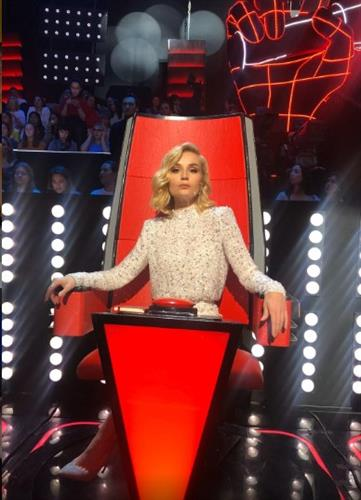 Russian singer and influencer Polina Gagarina sitting on the set of The Voice in Russia