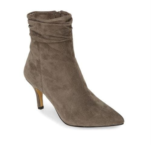 Pointed-toe suede ankle boot with draping around the ankle and a slim stiletto heel.