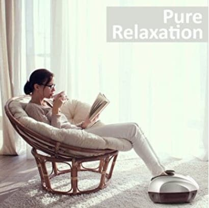 Woman sitting in circular cushiony chari with feet in a massager container